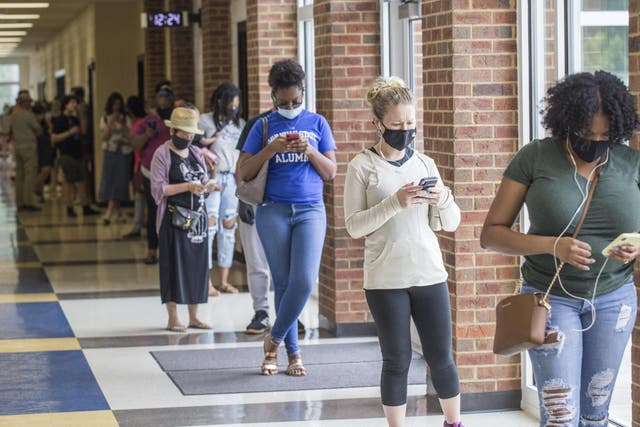Voters wait in long lines at Peachcrest Elementary School in Decatur, Georgia, to vote in the state's primary election, Tuesday, 9 June, 2020.