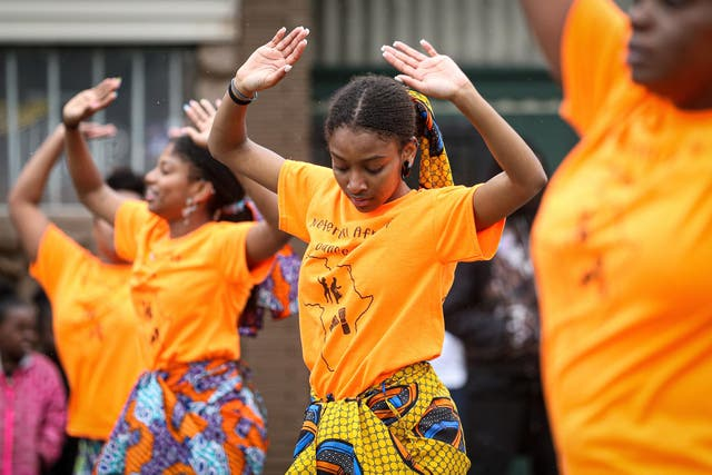 Members of a parade perform during the 48th Annual Juneteenth Day Festival in Milwaukee, Wisconsin.