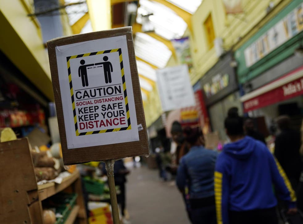 A sign encouraging social distancing in Brixton Market, London