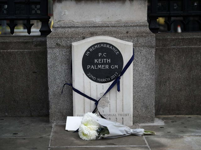 A bouquet of flowers is laid down at the memorial stone for PC Keith Palmer in London, Britain June 14, 2020