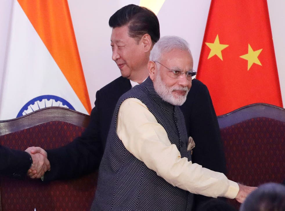 Indian prime minister Narendra Modi and Chinese president Xi Jinping at a summit in Goa, India. Tensions along the China-India border high in the Himalayas have flared again in recent weeks