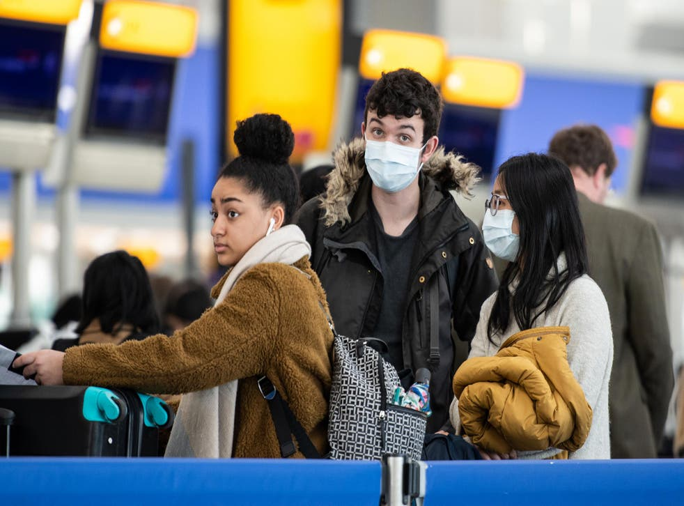 Passengers at Heathrow Airport, London, in March 2020