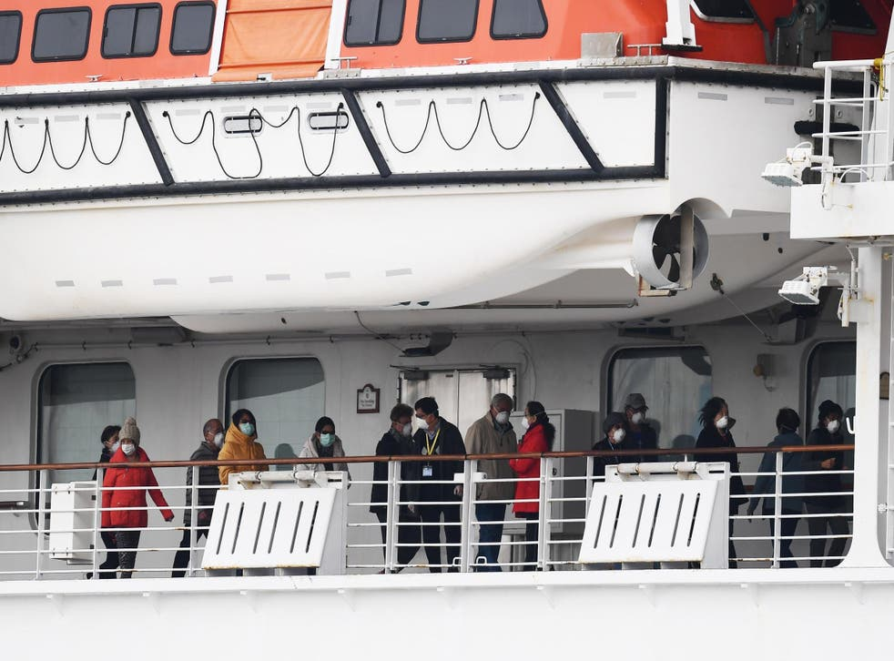 Passengers walk along the deck of the Diamond Princess cruise ship in February 2020.  Around 3,600 people were quarantined onboard due to fears of a coronavirus outbreak