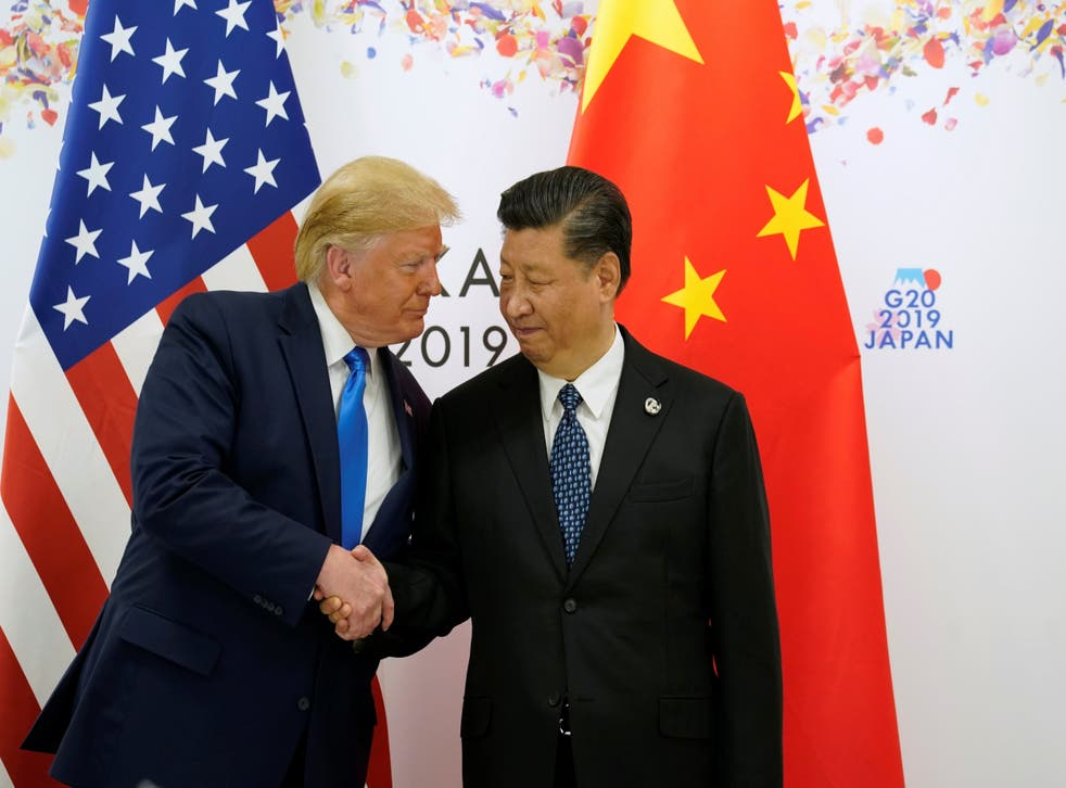 Donald Trump shakes hands with China's President Xi Jinping before starting their bilateral meeting during the G20 leaders summit in Osaka, Japan