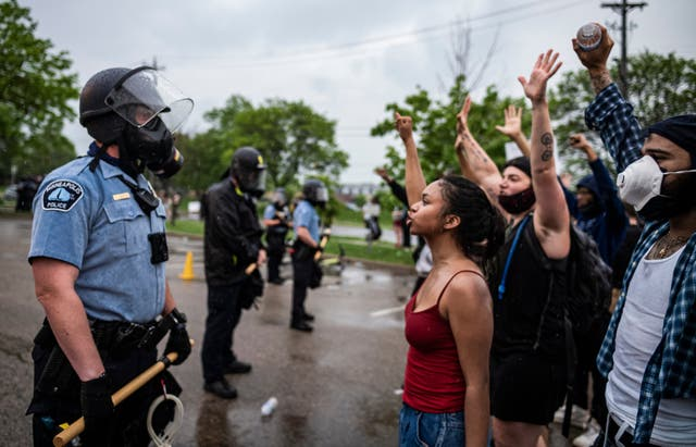 Protesters and police in Minneapolis. Star Tribune/AP