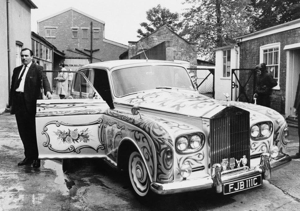 Anthony stands next to John Lennon's custom-built Rolls-Royce Phantom V in 1967