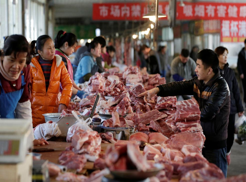 Meat stalls are seen at a market in Beijing, China