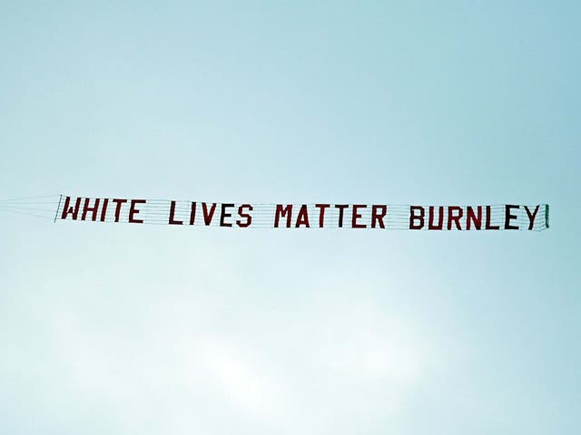 A message reading 'White Lives Matter Burnley' is flown over the Etihad Stadium