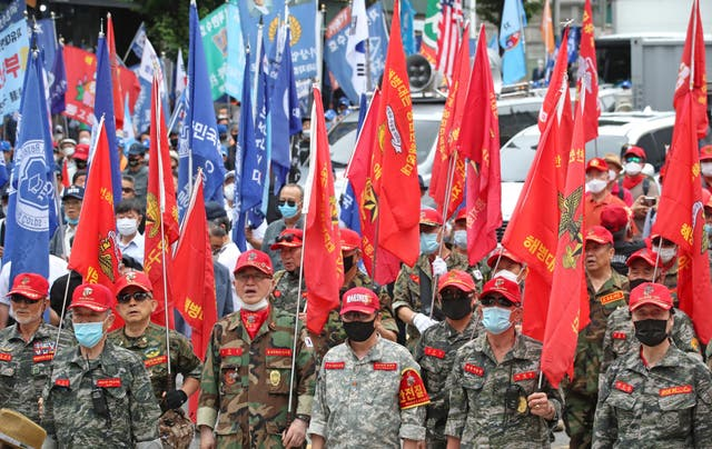 Veterans and conservative activists rally in southern Seoul, South Korea on Thursday to mark the 70th anniversary of the outbreak of the Korean War