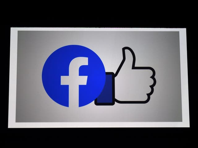 A Facebook App logo is displayed on a smartphone in Arlington, Virginia