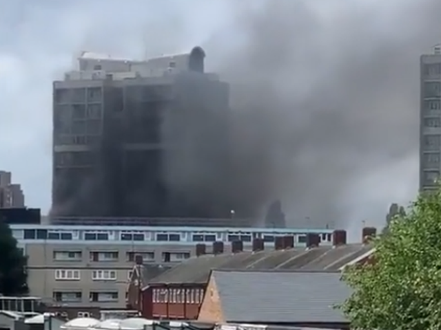 Thick smoke rising into the sky in south London from the blazing tower block