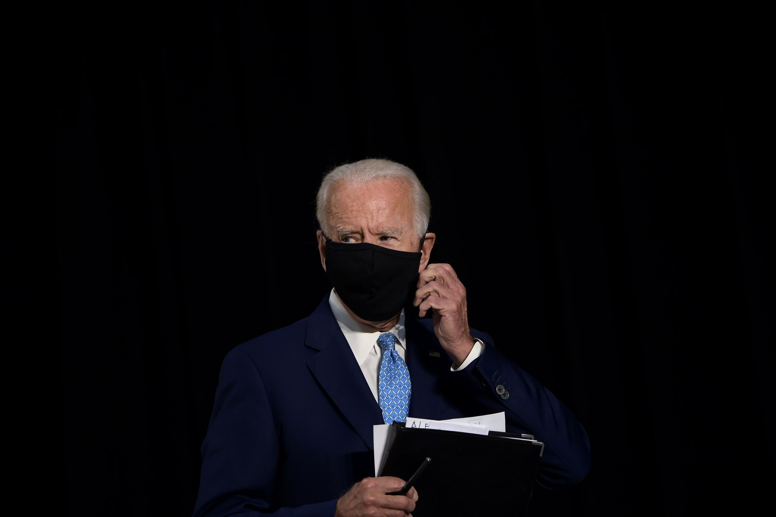 Coronavirus: Biden slams Trump and tells him to fix PPE shortages 'before you tee off another round of golf' photo