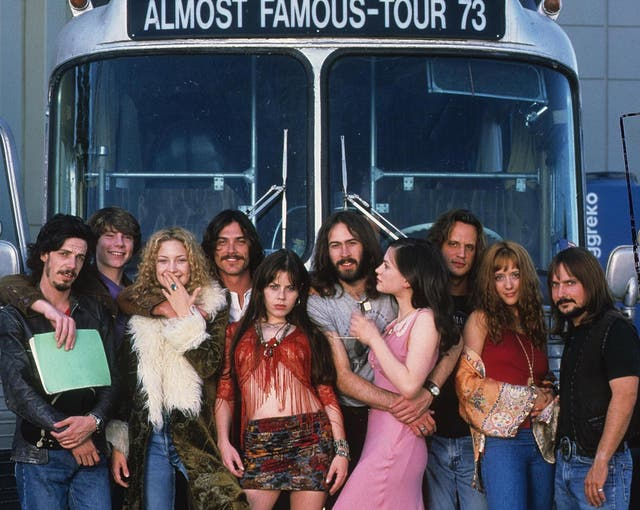 The lead cast, including Noah Taylor, Patrick Fugit, Kate Hudson, Billy Crudup, Fairuza Balk, Jason Lee and Anna Paquin, in front of Stillwater's tour bus