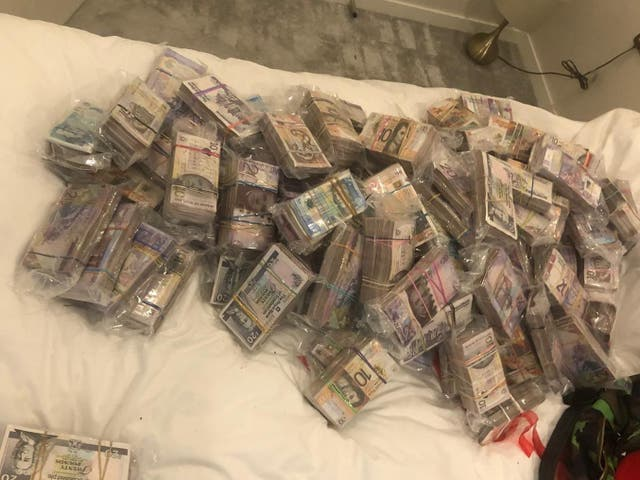 A quantity of cash seized by officers under Operation Venetic in London