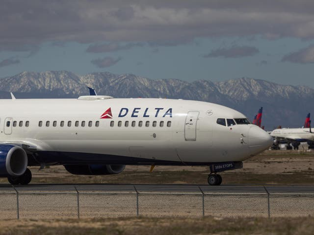 A Delta Air Lines jet taxis to be parked with a growing number of jets at Southern California Logistics Airport
