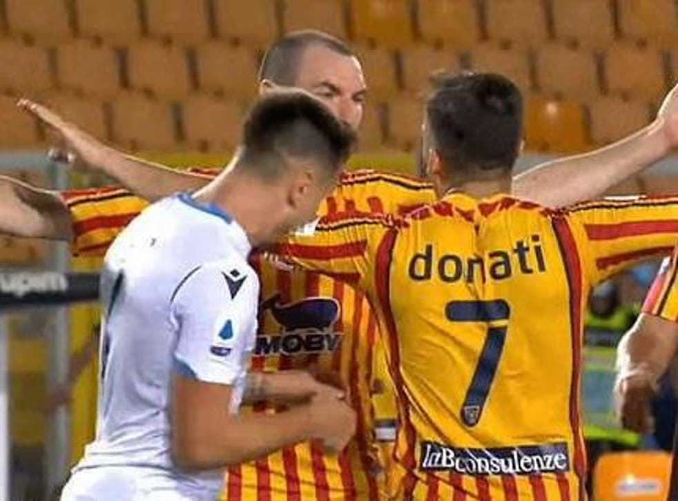 Patric appears to bite the left arm of Guilio Donati during Lazio's defeat by Lecce
