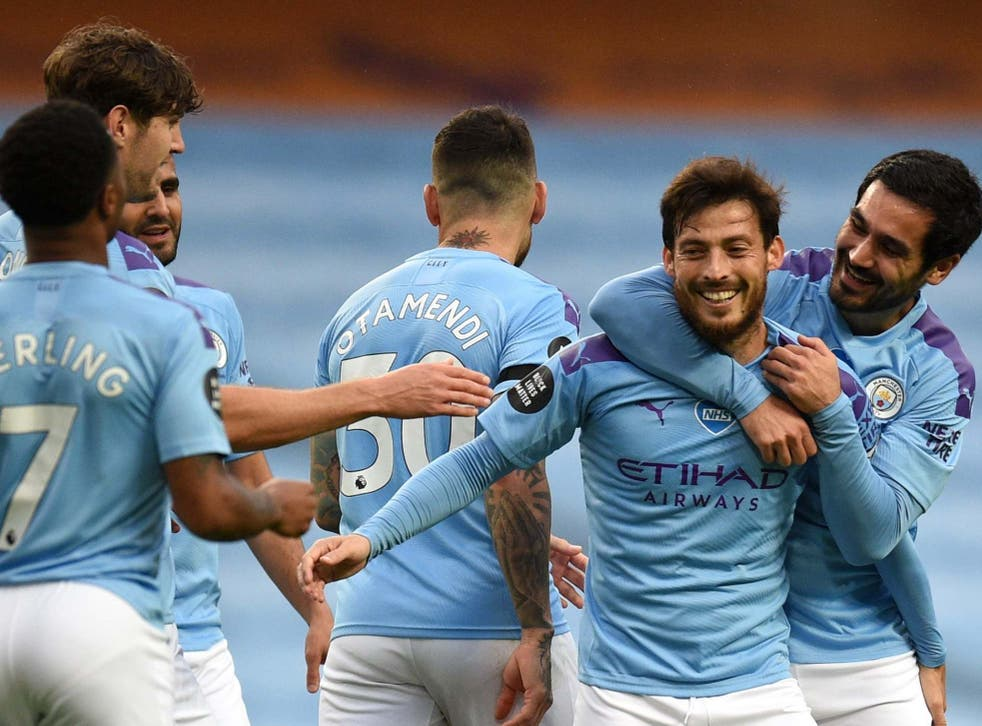 David Silva celebrates with teammates after scoring City's fourth