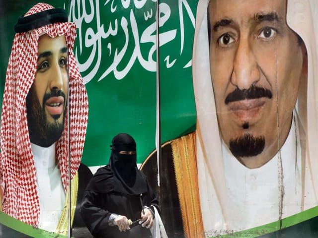 King Salman (right) and his son Mohammed bin Salman (left) on a poster in Riyadh, Saudi Arabia