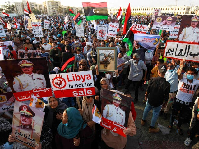 Supporters of Khalifa Haftar take part in a gathering in Benghazi this month