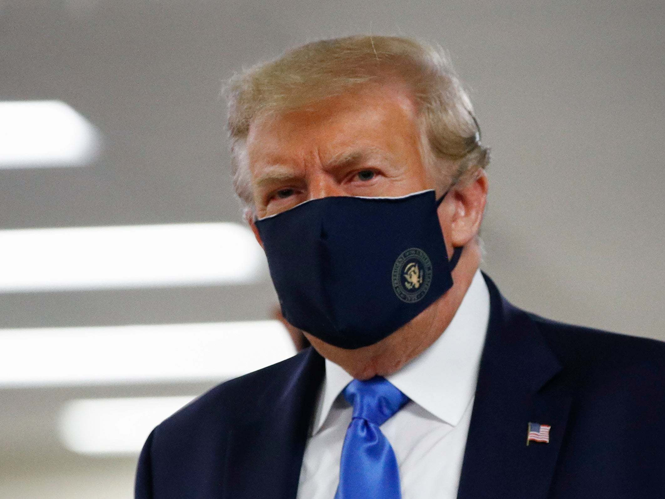 Trump news – live: President says 'shouldn't be hard' for Kanye West to siphon votes from Biden and wears mask in public for first time as coronavirus cases surge thumbnail