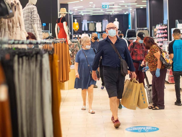 File photo of customers wearing face masks as they shop at Primark in Oxford Street, London.