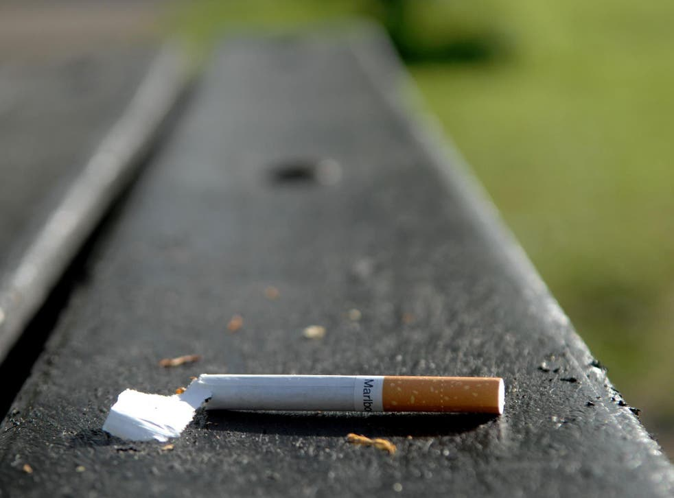 A discarded cigarette left on a bench in Wandsworth Common, London, on 14 April, 2020.