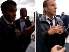 'You are my employee': Macron stopped by hecklers on Bastille Day walk with wife in Paris