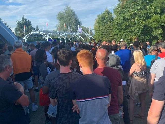 A crowd of people gathering at Thorpe Park in Surrey after reports of a police incident on Saturday evening