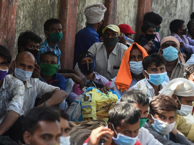 Millions of migrant workers in India (pictured) have been left destitute by the country's coronavirus lockdown