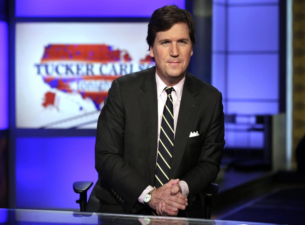 Tucker Carlson fronting his prime-time Fox News show from New York