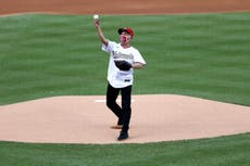 Dr Fauci throws out ceremonial first pitch to open baseball season