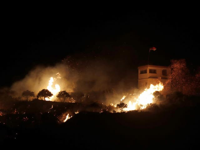 A fire following an Israeli helicopter attack on a Syrian observation post next to the village of Majdal Shams