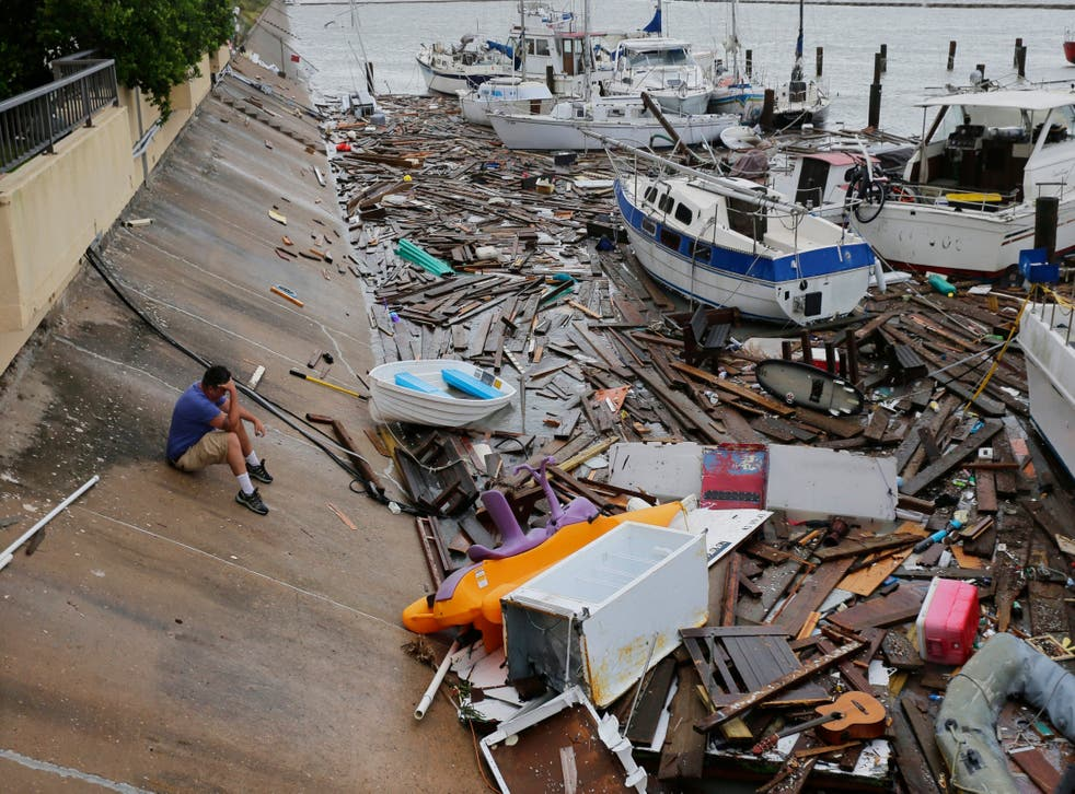 Allen Heath surveys the damage to a private marina in Corpus Christi, Texas after it was hit by Tropical Storm Hanna, which was downgraded from a hurricane as it hit land