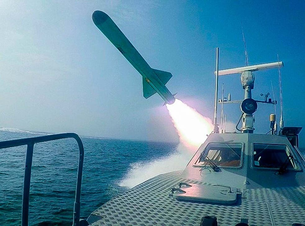 A Revolutionary Guard boat fires a missile during a military exercise on Tuesday