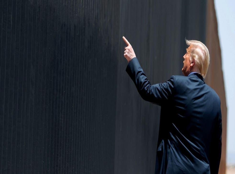 Trump having a look at his wall at the Mexican border.
