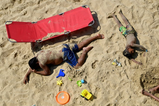 People enjoy the sunny weather at a Bournemouth Beach