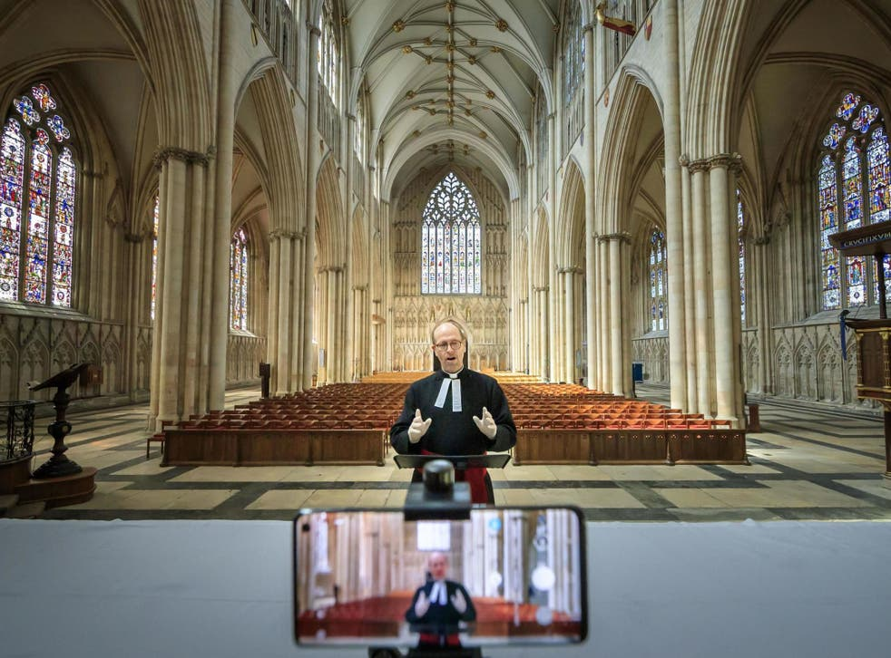 The Revd Michael Smith, York Minster's Canon Pastor, rehearses a digital Evensong service inside the cathedral, as the government moves towards the introduction of measures to bring the country out of lockdown
