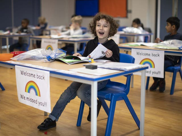 Children sit at individual desks during a lesson at the Harris Academy's Shortland's school on June 04, 2020