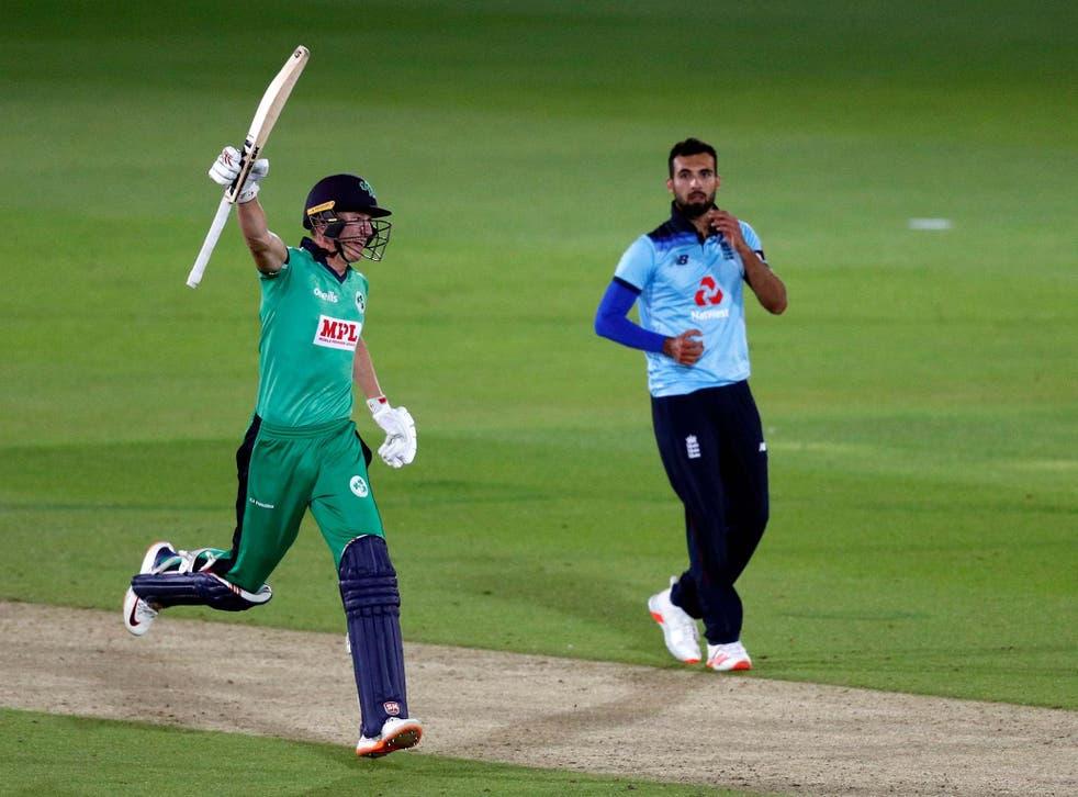 Harry Tector of Ireland celebrates victory watched on by Saqib Mahmood
