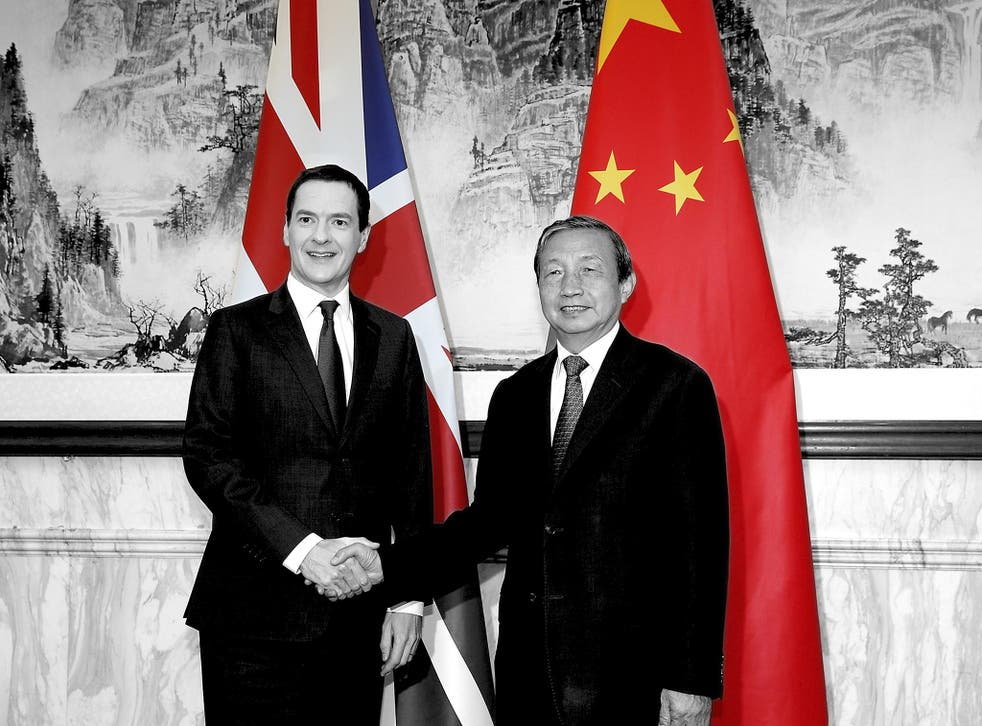Chinese vice president Ma Kai shakes hands with George Osborne, the then chancellor of the exchequer, in Beijing in September 2015