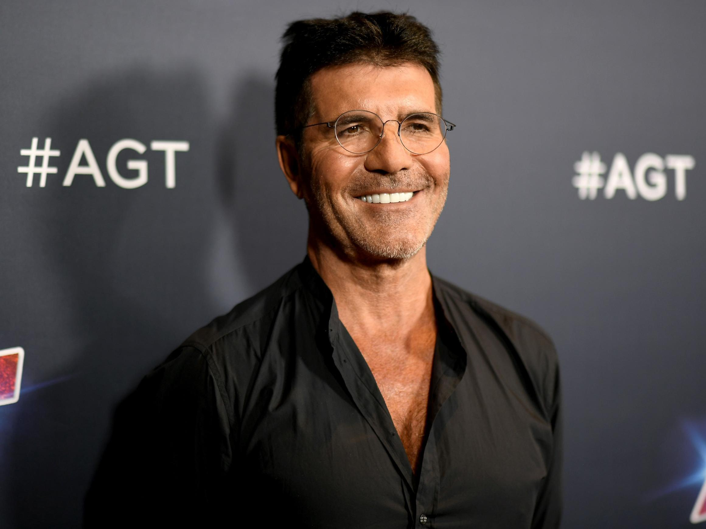 Simon Cowell In Hospital After Breaking Back On Family Bike Ride The Independent The Independent