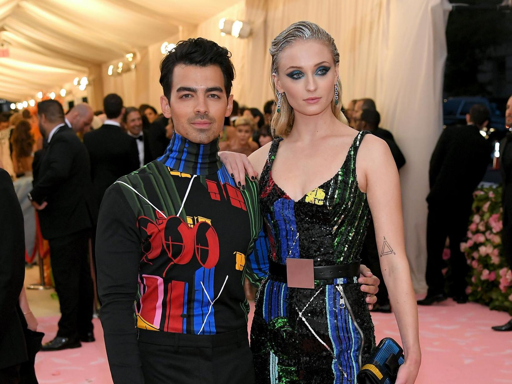 Joe Jonas and Sophie Turner urge fans to wear masks in first photo together since birth of their daughter
