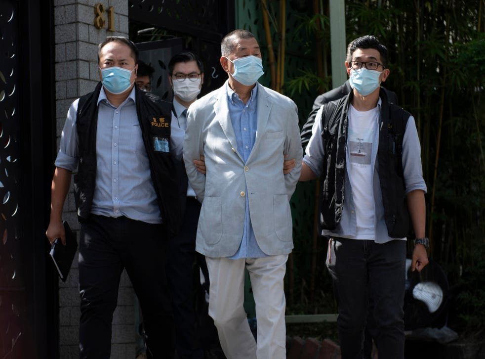 <p>A file image of Hong Kong media tycoon Jimmy Lai being taken away after his arrest in August 2020</p>