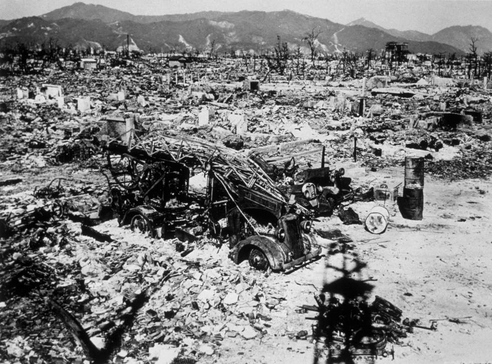 Atomic bomb damage at Hiroshima with a burnt out fire engine amidst the rubble in 1945