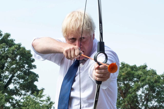 Prime Minister Boris Johnson takes part in an archery session as he visits Premier Education Summer Camp at Sacred Heart of Mary Girls' in Upminster