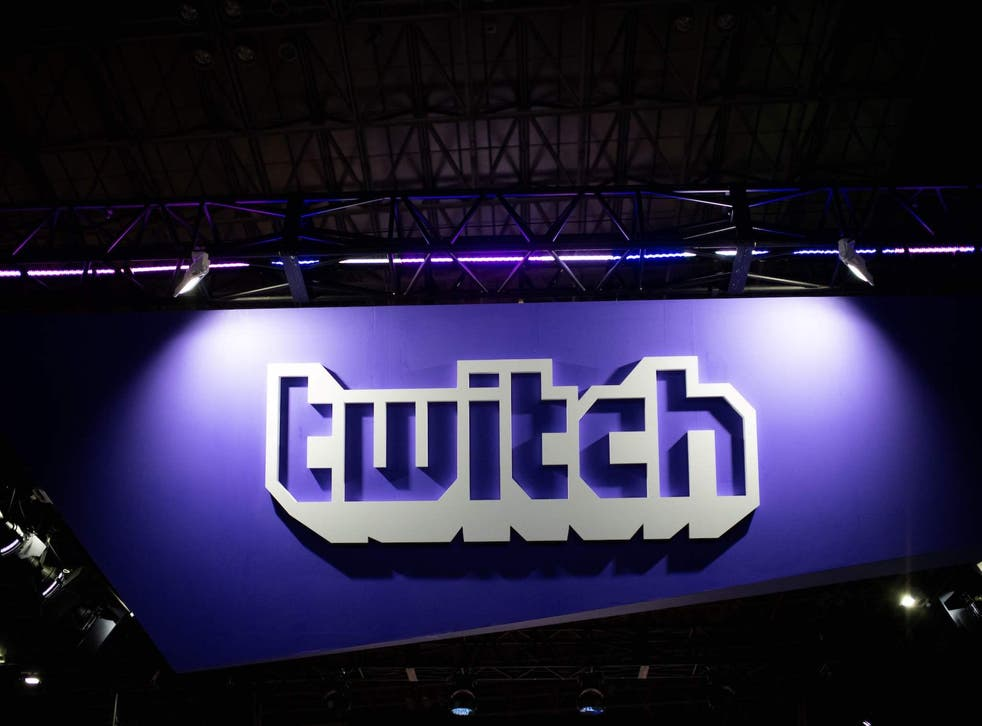A picture taken at the Tokyo Game Show on September 21, 2018, shows the logo of the VOD and streaming video games company Twitch