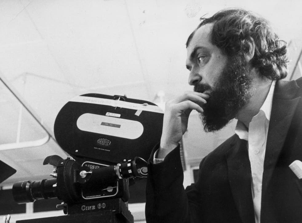 Renowned filmmaker and innovator Stanley Kubrick stands beside a camera in March 1975