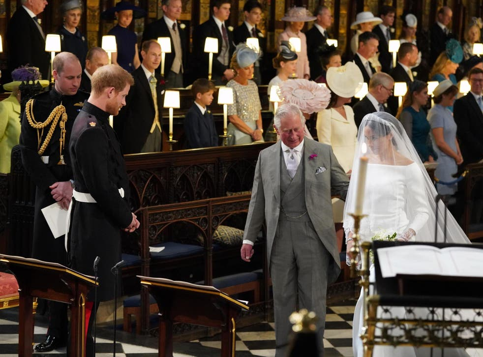 Meghan Markle is accompanied by Prince Charles down the aisle at St George's Chapel in Windsor Castle, 19 May 2018