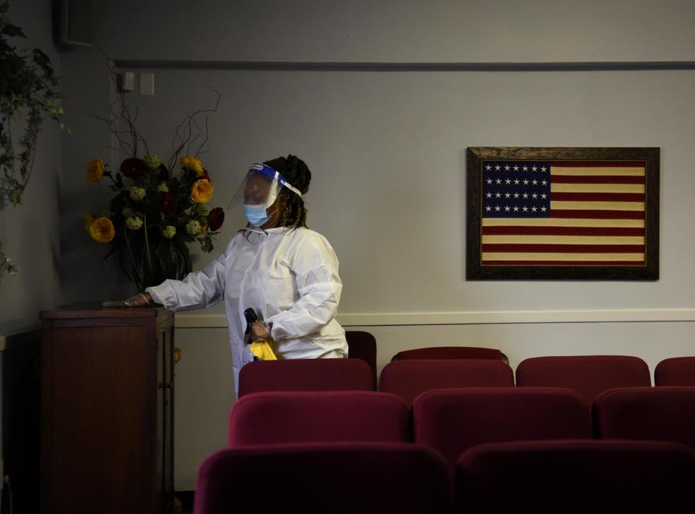Shayla Williams, 39, disinfects surfaces to prevent the spread of the coronavirus at Beresford Funeral Service in Houston, Texas. The US has seen more than 166,000 deaths during the pandemic, ranking it first for total fatalities.