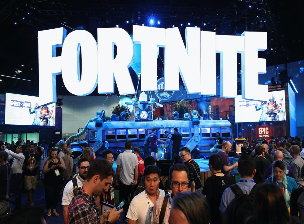 Game enthusiasts and industry personnel visit the 'Fortnite' exhibit during the Electronic Entertainment Expo